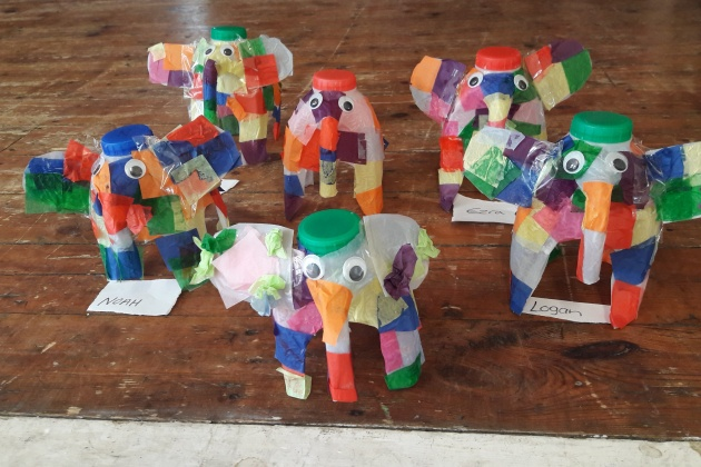 Multi-coloured small elephants made from milk cartons
