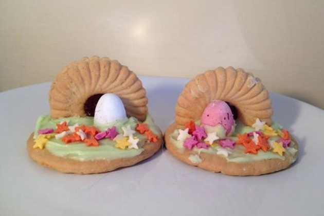 two biscuits with mini-eggs and green and pink icing to represent the tomb of Jesus